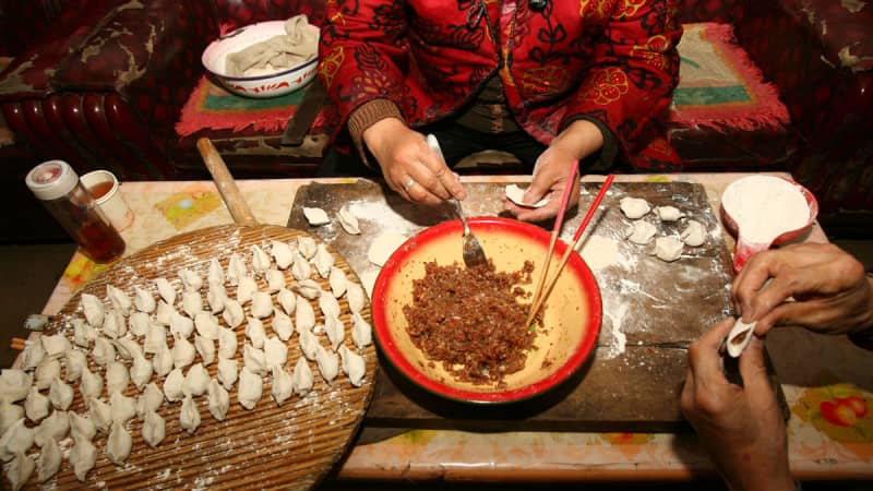Food is an important part of the celebrations. Here, dumplings are prepared Lunar New Year.