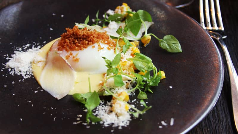 A perfectly poached egg with corn and parmesan at Septime. The no-choice menu changes seasonally.