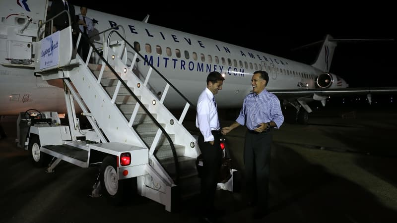 Mitt Romney (right) and running mate Paul Ryan stand outside the 1970 DC-9-32 aircraft.