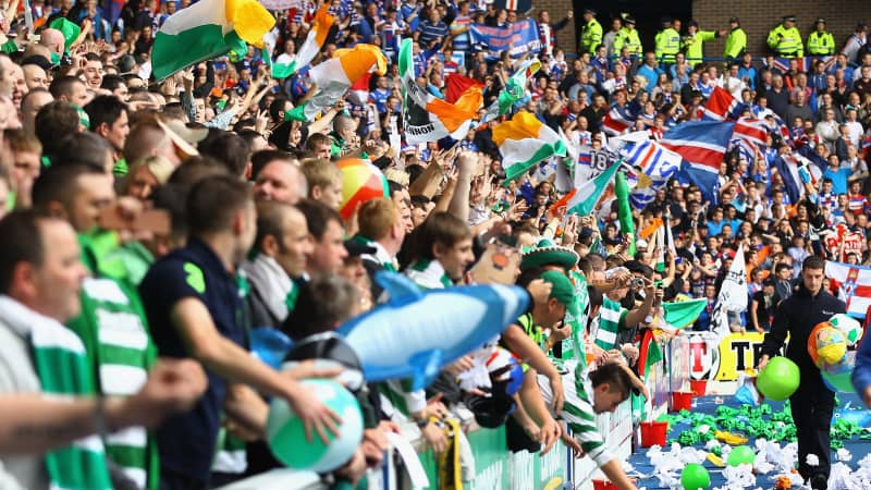 Celtic and Rangers fans show their support before an Old Firm game at Ibrox Stadium in 2011.