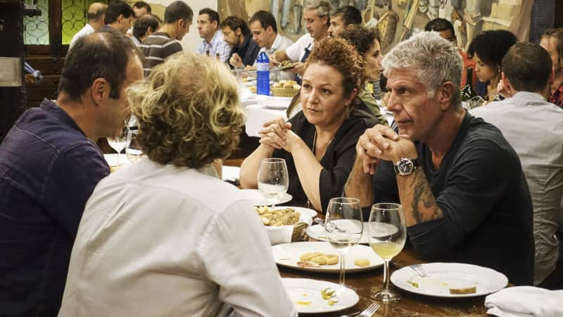 Anthony Bourdain in conversation over a traditional meal at Aizepe, a gastronomic society in the heart of San Sebastian's Old Town.
