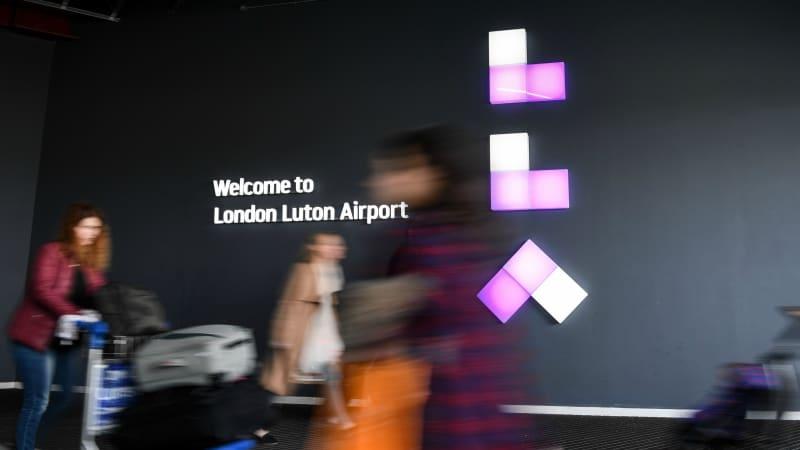 Passengers passing LLA Logo