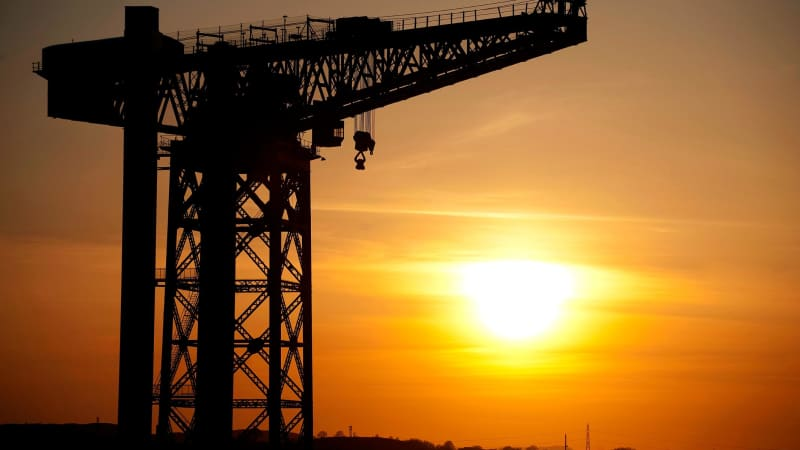 The sun sets over the iconic Govan Shipyards on the River Clyde.