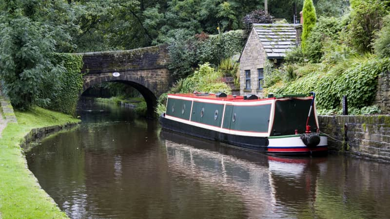 Narrowboats ply the canal waters of the Standedge Tunnel.