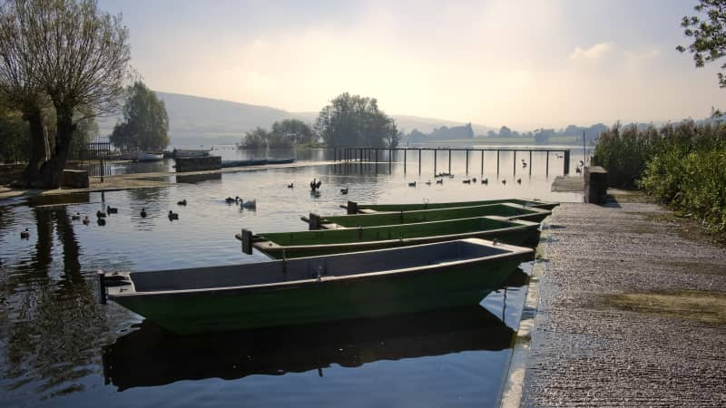 Picturesque Llangorse Lake lies in the Brecon Beacons National Park.