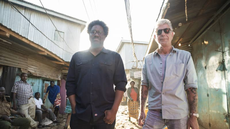 Anthony Bourdain with W. Kamau Bell in the Kibera slums in Nairobi, Kenya in February 2018 during the filming of Season 12 'Parts Unknown.'