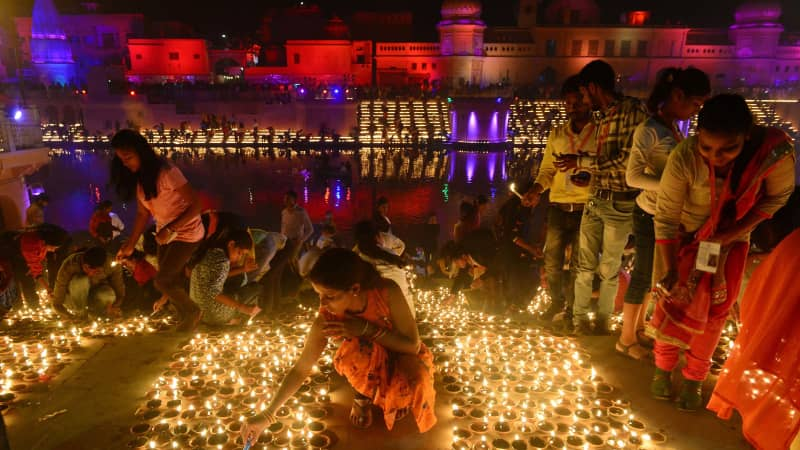 "Indian people light earthen lamps on the banks of the River Sarayu on the eve of ""Diwali"" festival during a ""Deepotsav"" event organised by the Uttar Pradesh government in Ayodhya on November 6, 2018"