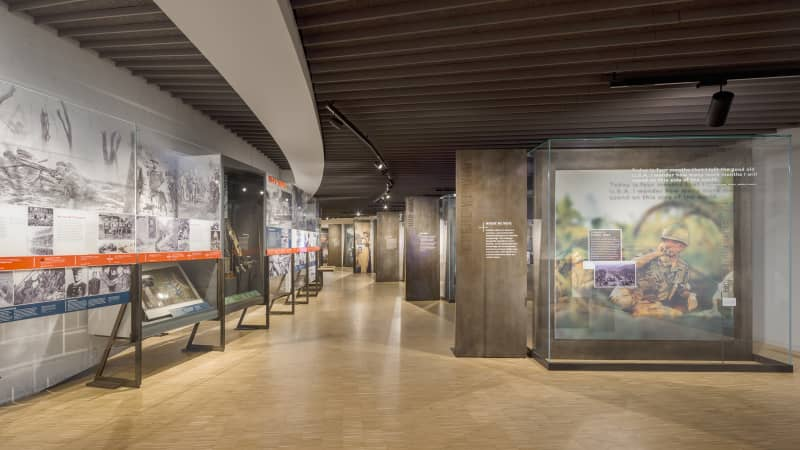 The history of the military is featured in a timeline installation that sits opposite interactive features.