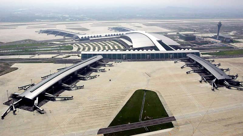 GUANGZHOU, CHINA: This aerial view shows the new Baiyun International Airport in the southern Chinese city of Guangzhou, 15 June 2004. The new Guangzhou Baiyun International Airport is now running its final checks by experts from the Civil Aviation Administration and is scheduled to start operations on July 08. AFP PHOTO (Photo credit should read AFP/AFP/Getty Images)