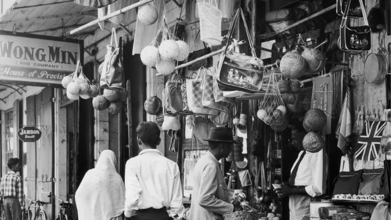 Mauritius circa 1955. Household items are displayed outside an Indian merchant's shop in Port Louis.