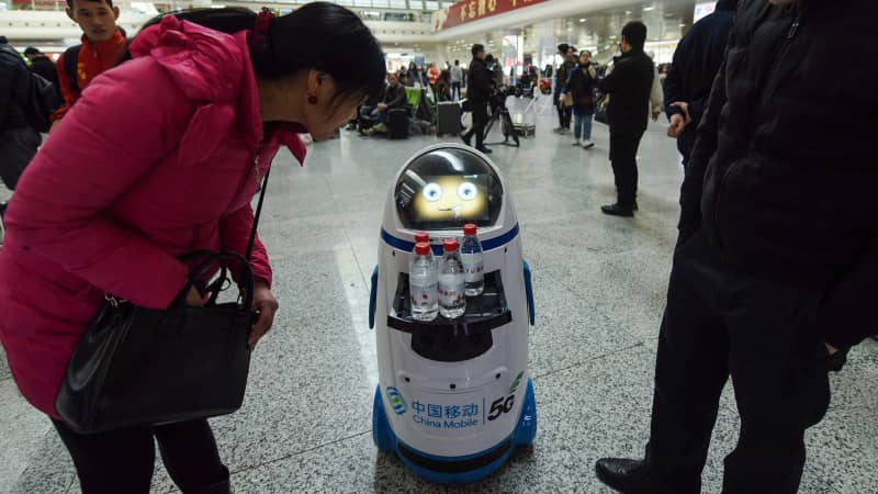 A 5G robot serves free bottles of water at East Railway Station in Hangzhou in China's eastern Zhejiang province on the first day of the 2019 Spring Festival travel rush.