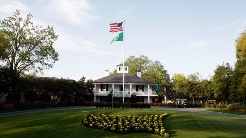 Patrons can get their photos taken in front of the Augusta National club house.
