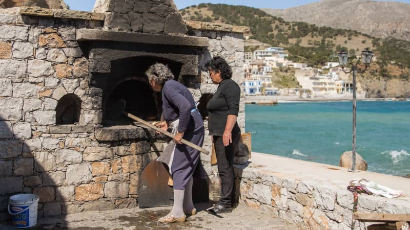 Baking bread in large, outdoor brick ovens is a part of the way of life in Olympos.