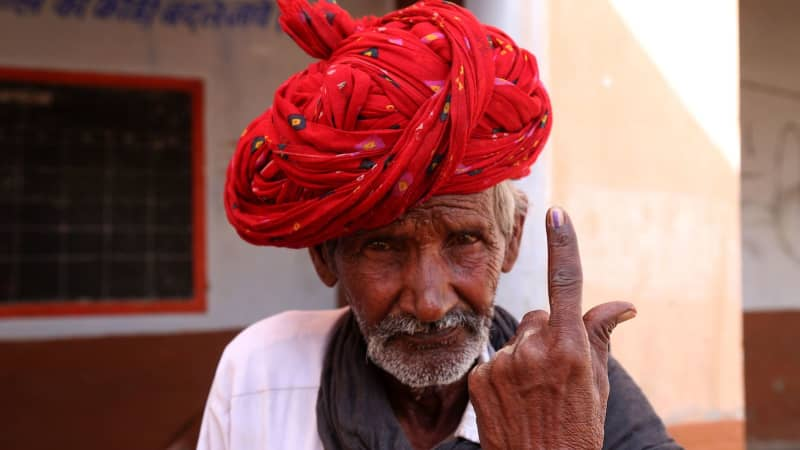 A man shows his ink-marked finger after casting his vote in the outskirts of Ajmer, in the Indian state of Rajasthan, on April 29.