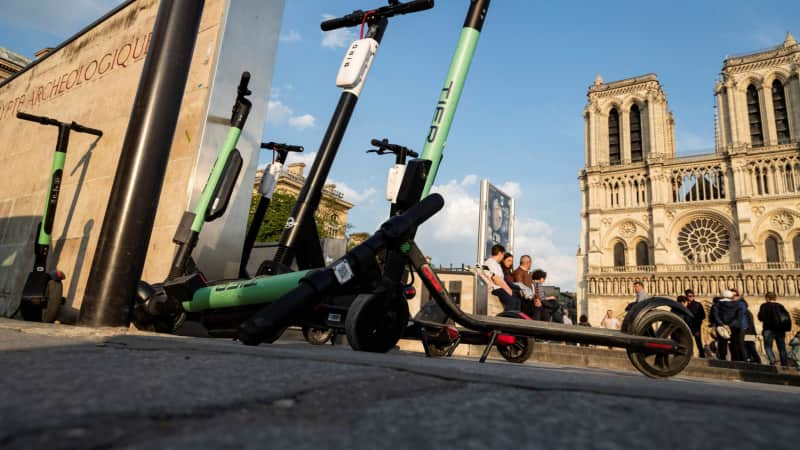 Electric scooters from apps Tier and Bird in front of the Notre Dame Cathedral.