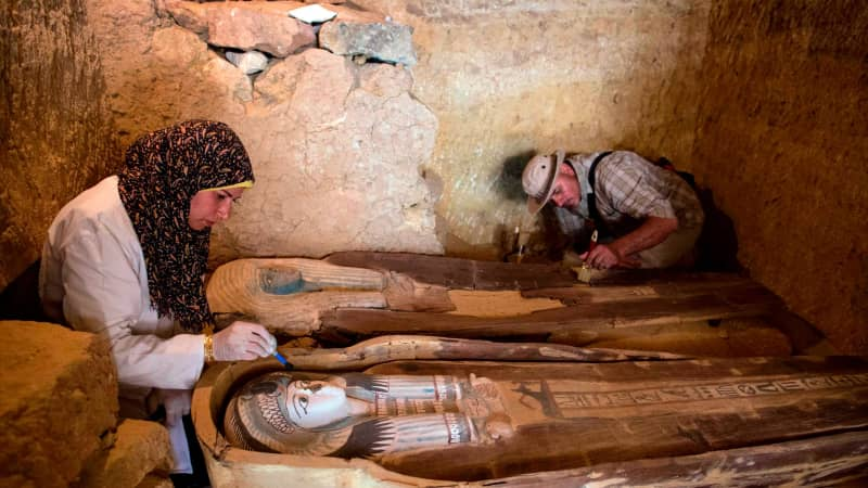 Excavation workers inside the tomb