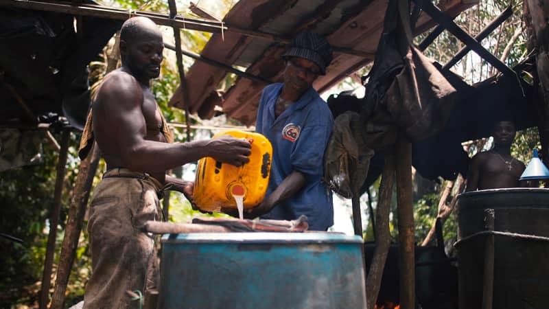 Men in Nzulezo take pride in making local gin, Akpeteshi.