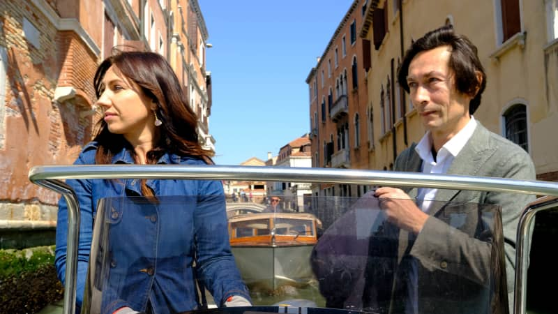Local activist Marco Gasparinetti and his wife navigate oncoming traffic in a residential area of Venice.