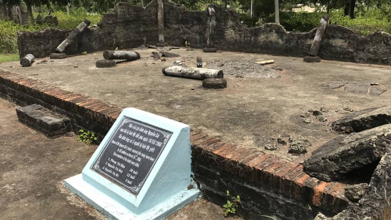 The foundation of a hut in My Lai village, destroyed by US troops on March 15, 1968. The marker in front lists those who lived there and died in the My Lai massacre.