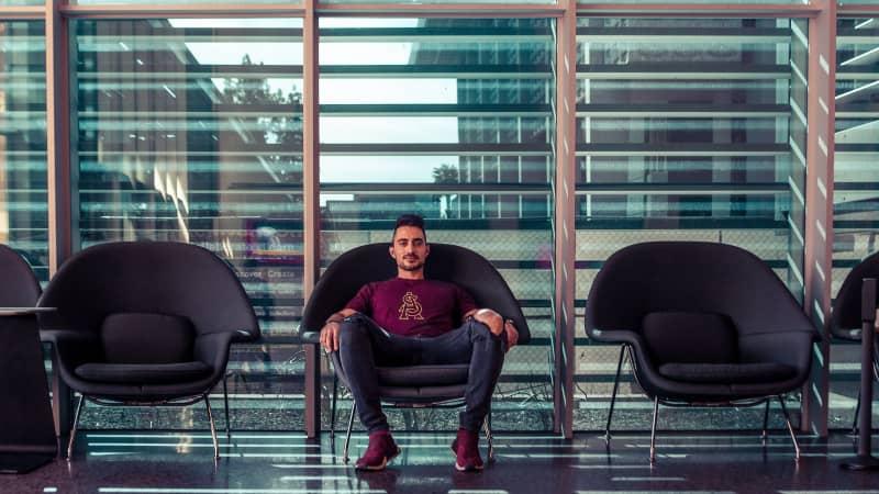 Man seated on armchair