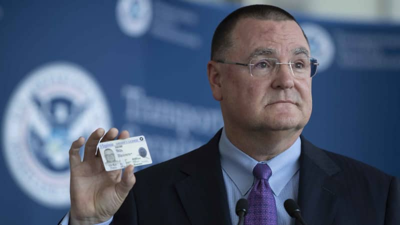 Todd Hauptli, CEO of the American Association of Airport Executives, shows his REAL ID-compliant driver's license during a news conference at Ronald Reagan Washington National Airport on October 1, 2019.