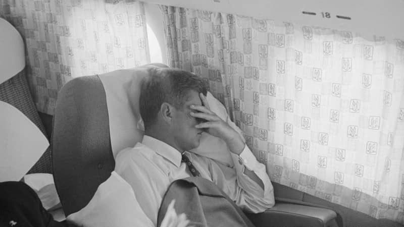 During his 1960 campaign, John F. Kennedy catches some rest while en route from St. Louis to New York City.