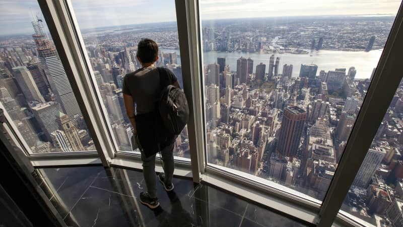 Visitors take in views of Manhattan from the newly renovated 102nd floor observatory of the Empire State Building.