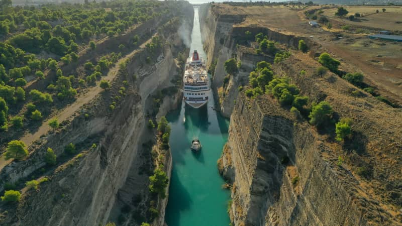The Corinth Canal connects the Gulf of Corinth with the Saronic Gulf.