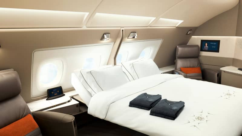 Snooze in luxury: Adjacent suites in first class at Singapore Airlines can be combined so that couples can share a larger space and double bed.