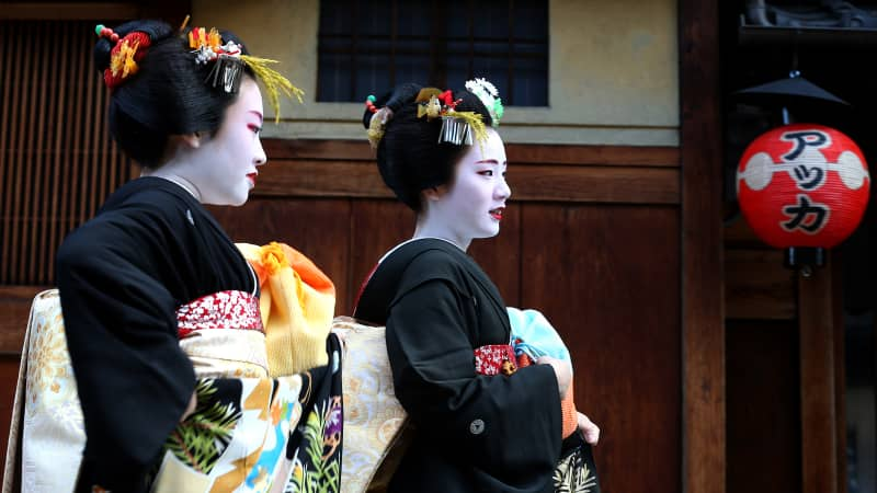 Japanese geisha and their apprentices walk in the street during an annual new year's ceremony at the Gion Kobu Kaburenjo Theater on January 7, 2016. The area is one of Kyoto's most popular tourist destinations.