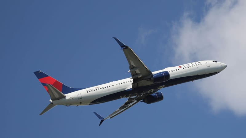 Delta's announcement tells passengers to ask flight attendants for assistnace.