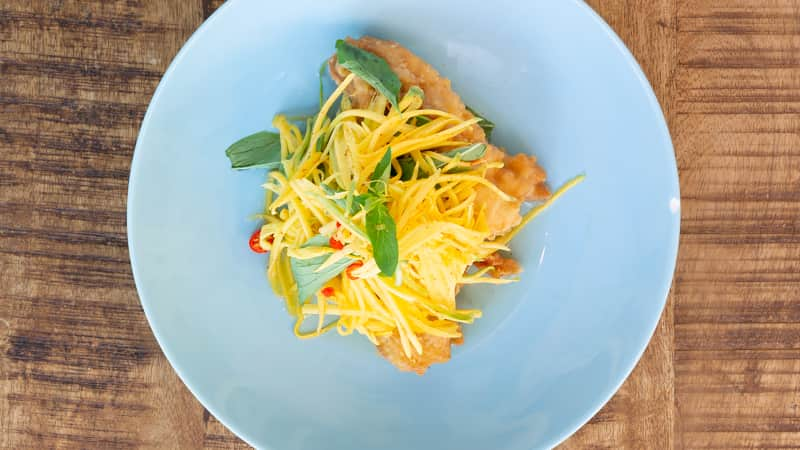 Fried Fish Fillets with Mango Salad (Trei Jien) from Nite Yun are a part of the chef's history.