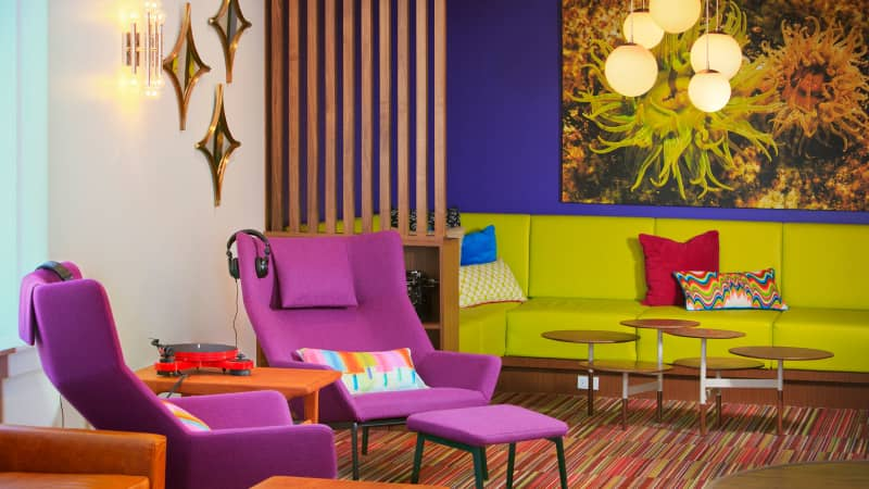 In the Hotel Zed Kelowna lobby, mod light fixtures and low-slung couches make for an inviting atmosphere.
