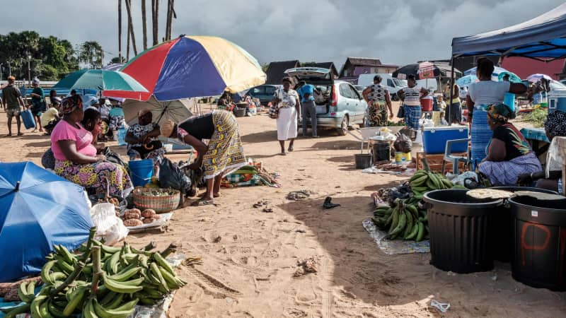 Produce sellers create a makeshift market located on the shore in Saint-Laurent du Maroni, Guyane.