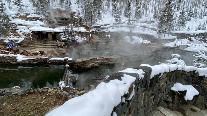 The lower hot pool butts up against the cold water creek, where participants can 'cool off' in 40-degree water.