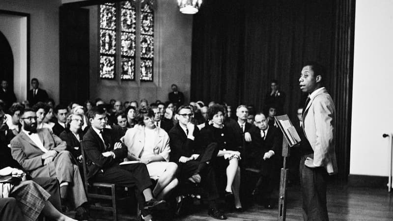 Author and activist James Baldwin gives a talk in Paris in 1963.