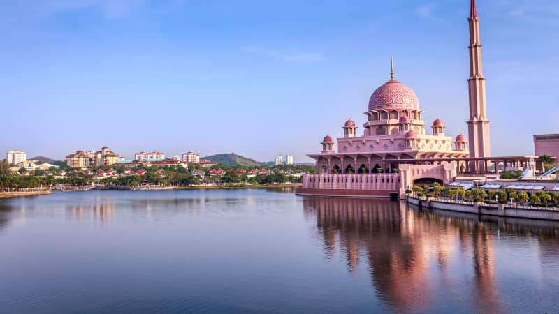 Putra Mosque in Putrajaya, Malaysia, is located at the edge of a manmade lake.