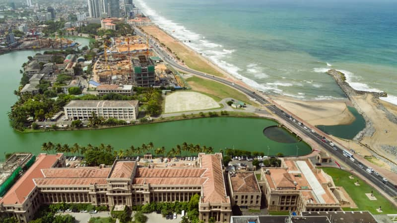 Beaches line the urban waterfront of Colombo, home to Sri Lanka's national and executive bodies of government.
