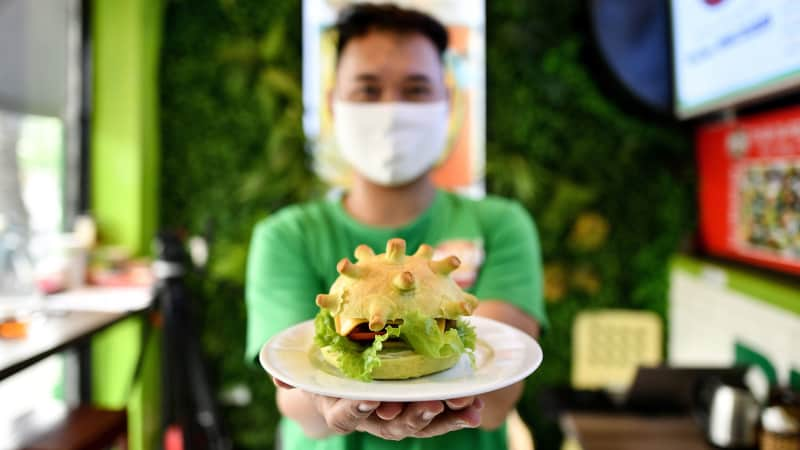 A coronavirus-themed burger is pictured at the Pizza Home restaurant in Hanoi on March 26, 2020, amid restrictions being put in place to contain the spread of the COVID-19 coronavirus