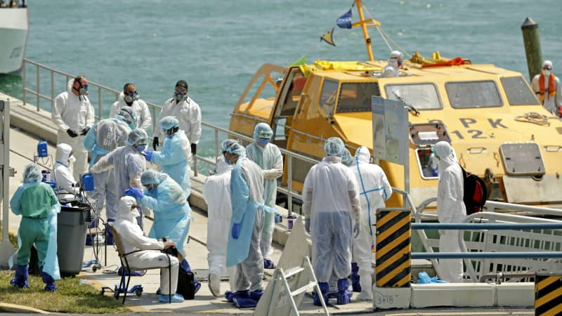 Healthcare workers evacuating cruise members from the Costa Favolosa.