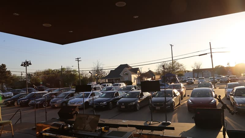 Cars in the Plaza Theatre parking lot waiting for the performance.