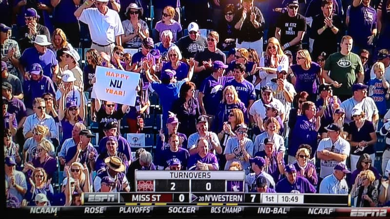 The sign-holding author appeared on ESPN2 during the 2013 Gator Bowl in Jacksonville, FL, when Northwestern finally won their first bowl game in 64 years.