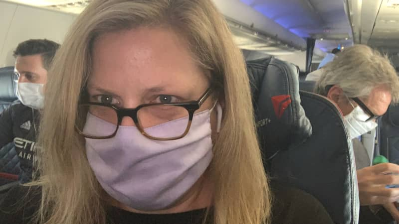 The author's selfie aboard a nonstop Delta flight from New York City to San Francisco.