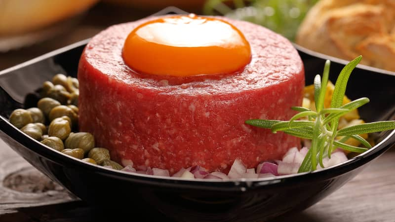Similar to steak tartare, this appetizer is made of minced meat mixed with onions and egg yolk.