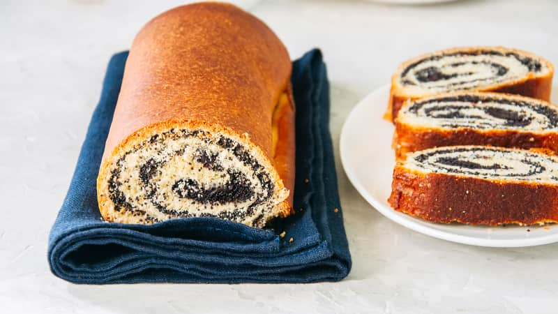 Makowiec -- a roll of sweet yeast bread with a filling of poppy seed.