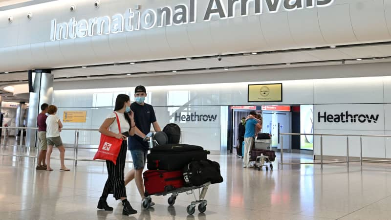 Travelers at the arrivals hall at Terminal Two of London Heathrow Airport on May 9, 2020