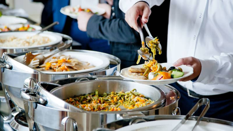 Elbow-to-elbow, serve-yourself buffets are unlikely to resurface anytime soon.