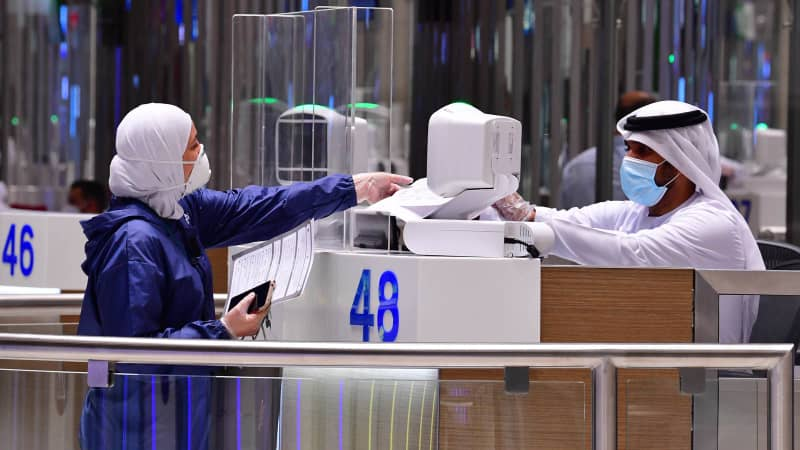 A tourist gets her papers checked upon arrival at Teminal 3 at Dubai airport.
