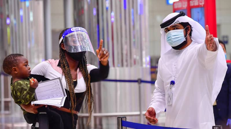 A tourist receives instruction at Dubai airport in the United Arab Emirates.