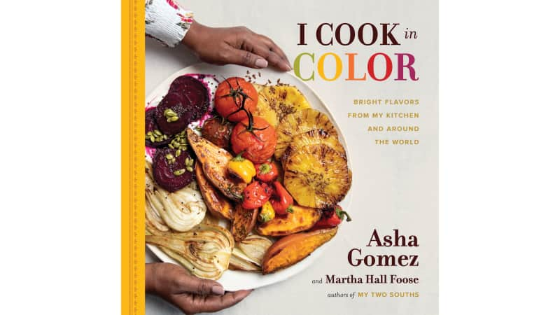 Asha Gomez's second cookbook focuses on colorful ingredients and the power of family.